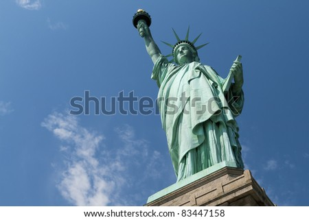 The Status of Liberty against the blue sky. - stock photo