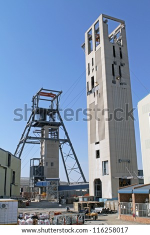 The steel and concrete structure of the headgear of a gold mine in South Africa - stock photo