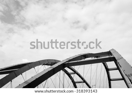 The steel construction of the red bridge. Black and white  - stock photo