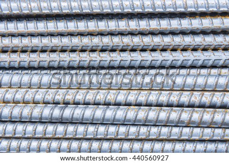 The steel deform bar or steel rod pile on the construction site with the  corrosion  cause of rusty. - stock photo