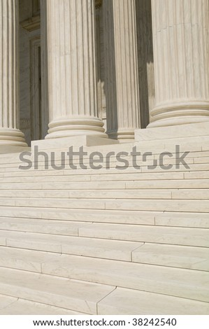 The steps and columns at the entrance to the US Supreme Court in Washington, DC. - stock photo