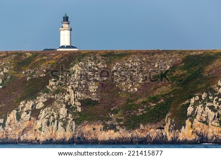The Stiff lighthouse on the cliff top in ushant island, Brittany, France - stock photo