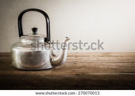 the still life old aluminium kettle. vintage tone - stock photo