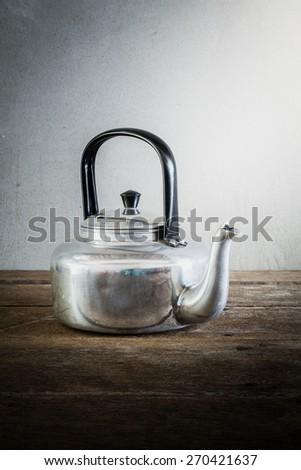 the still life old aluminium kettle. vintage tone - stock photo
