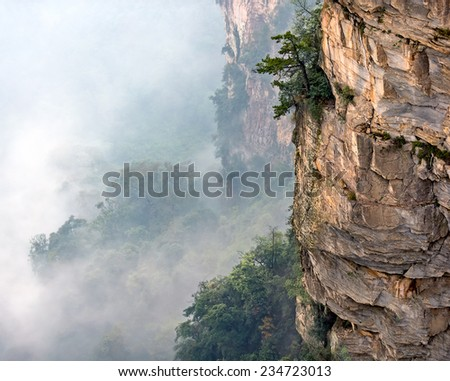 The stone columns mountain (Avatar rocks) in the mist. Zhangjiajie National Forest Park was officially recognized as a UNESCO World Heritage Site - China - stock photo