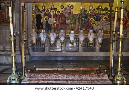 The Stone of the Anointing (The Stone of Unction) in Church of the Resurrection, Old City of Jerusalem, Israel - stock photo