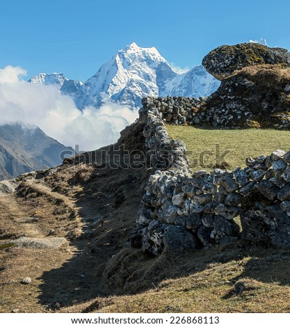 The stone walls around the margins around the track to Everest - Gokyo region, Nepal, Himalayas - stock photo