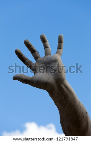 the stony hand against the background of the sky. Roma - Piazza Navona square, Italy. Detail of the Fountain of the Four Rivers, showing of the river-god Ganges. - stock photo