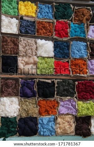 The Storage Boxes for Coloured Wool, Yarn and Material. - stock photo