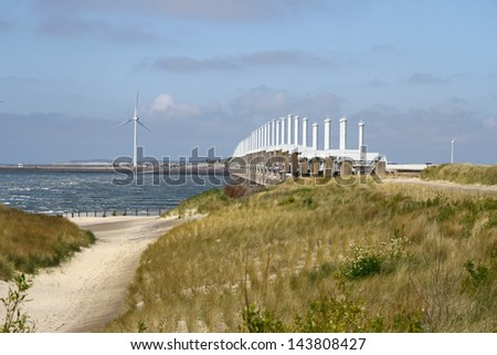 The storm surge barrier Oosterschelde near Neeltje Jans in The Netherlands - stock photo