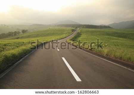 The straight road of twilight - stock photo