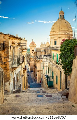 the street leading down at the famous town of Sicily - Noto, the capital of baroque style - stock photo