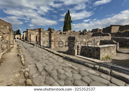 The street with remains of roman buildings in Pompeii, Italy - stock photo