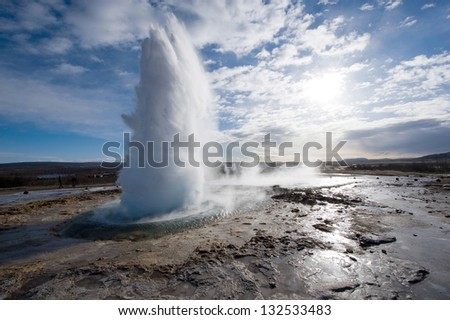 The Strokkur geyser in Iceland is erupting in the winter - stock photo
