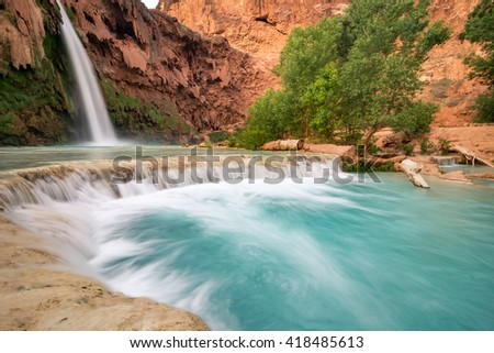 The stunning scenery at Havasu Falls after a long hike through the desert of Arizona - stock photo