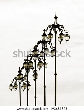 The style of old lamps on the bridge near the Moscow Kremlin (stylized retro) - stock photo