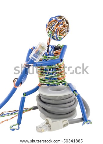 The stylized little man made of a computer cable sits on spool UTP and looks on blue patch cable. Isolated on white. With clipping path. - stock photo