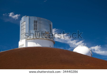 The Subaru Observatory atop the Mauna Kea volcano in Hawaii Big Island. Part of the Keck Observatory is also visible. - stock photo