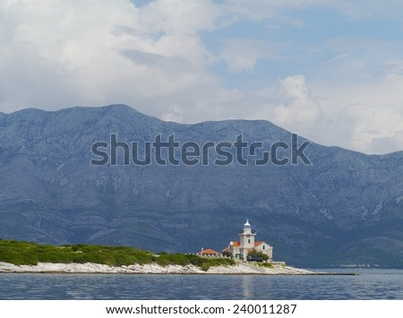 The Sucuraj lighthouse on the east point of the island Hvar in the Adriatic sea of Croatia - stock photo