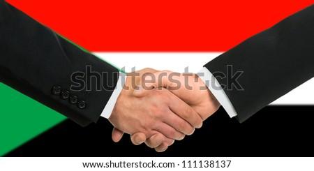 The Sudan flag and business handshake - stock photo