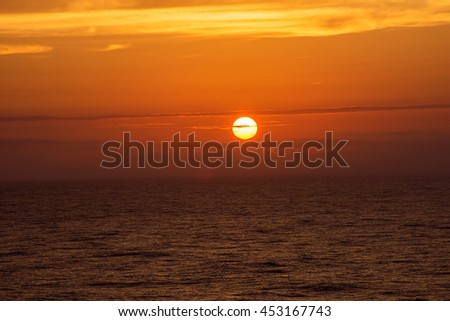 The sun goes down over the North Atlantic as seen from a cruise ship. - stock photo