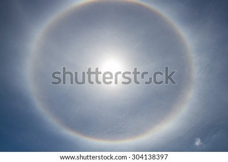 The sun halo on the sky in day time. - stock photo