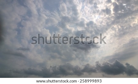 The sun is behind the black sky - stock photo