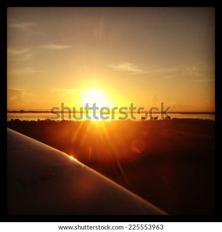 The sun is setting on the horizon of the sea. - stock photo