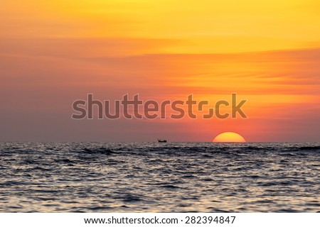 The sun is setting over the Indian Ocean, Aceh, Indonesia - stock photo
