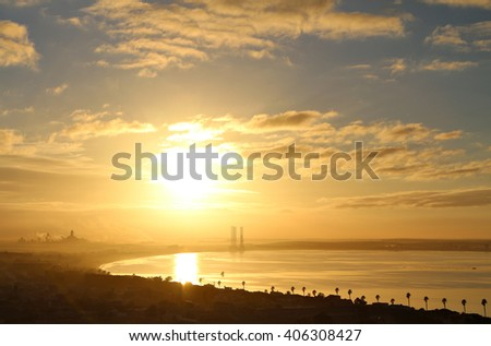 The sun rises over the natural harbour of Saldanha Bay in the Western Cape, South Africa. - stock photo