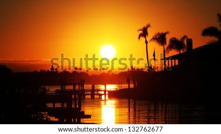 The Sun Setting Over the Intercoastal in Madeira Beach, Florida - stock photo