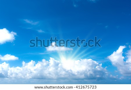 The sun shines bright in the daytime . Blue sky and clouds. - stock photo