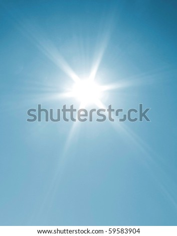 The sun shining on a cloudless day - stock photo