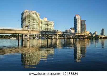 The Sundale Bridge at Southport Gold Coast Australia with reflections in the water just after sunrise. - stock photo