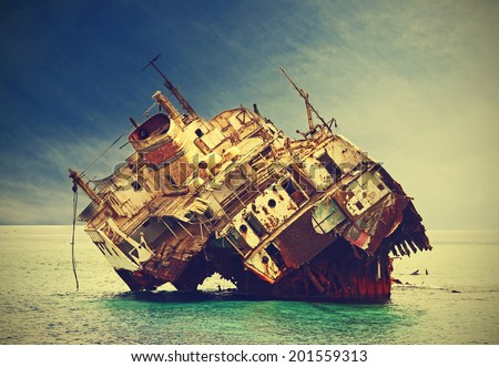 The sunken shipwreck on the reef, Egypt, vintage retro filtered.  - stock photo
