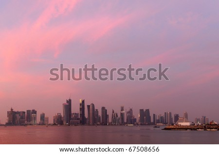 The sunset over Doha bay on National Day, Dec 18, 2010, with the high-rise skyline. - stock photo