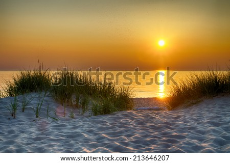 The sunset over Lake Michigan as seen from the Esch Road Beach, part of the Sleeping Bear Dunes National Lakeshore. - stock photo