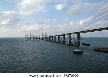 The Sunshine Skyway Bridge - spanning Tampa Bay south of St. Petersburg, FL - shown from the water facing Northeast (Cable Stay type bridge) - stock photo