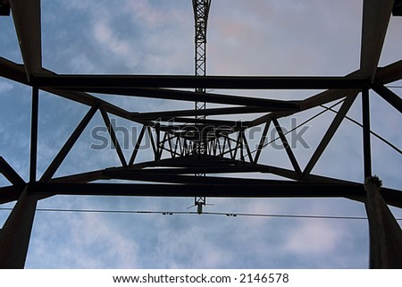The support of high-voltage wires. The bottom view. - stock photo