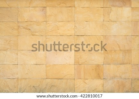 the surface of big stone Cladding brick wall, beautiful brick wall, Stone Wall Cladding is dirty white. background texture - stock photo