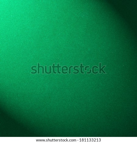 The surface of the green velvet cover on the pool table - stock photo