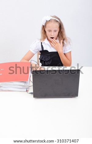 The surprised girl using his laptop computer on white background. - stock photo