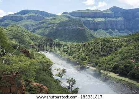 the swadini dam and blyde river the dragensberg as background - stock photo