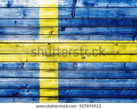 The Swedish flag painted on wooden fence - stock photo