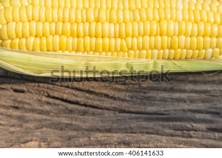 the sweet corn with wooden background in horizontal scen - stock photo