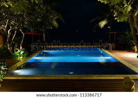 The swimming pool at night without people. - stock photo