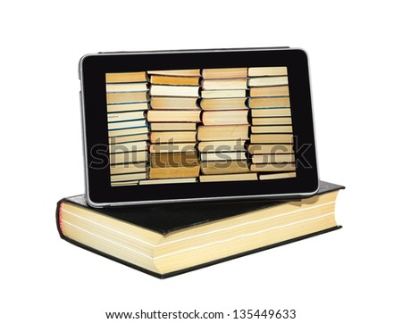 The Tablet-PC is on the hardcover book - stock photo