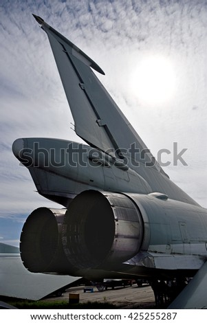 The tail of the plane against the sky and sunlight - stock photo