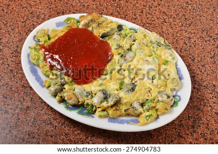 The Taiwan distinctive traditional snack of oyster omelet.             - stock photo