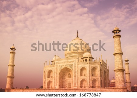 The Taj Mahal of India seen from a side angle up close with a warm color tone. - stock photo